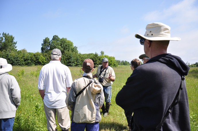 Doug McRae tells members about bobolinks and meadowlarks during a guided walk (Braham Tract, Jun 11, 2016). (credit: Dalila Seckar)